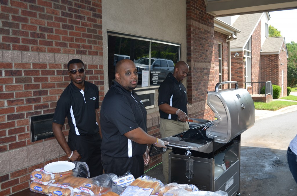 Enterprises staff cooking food for the kids.
