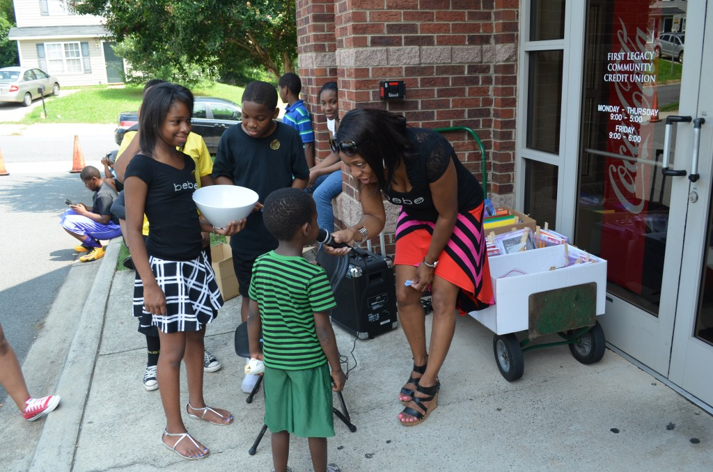 Tamica Dawkins CEO interacting with students.