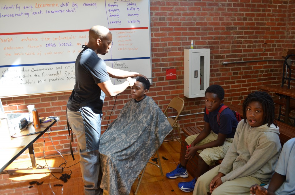 Duane Goodwin providing free haircuts