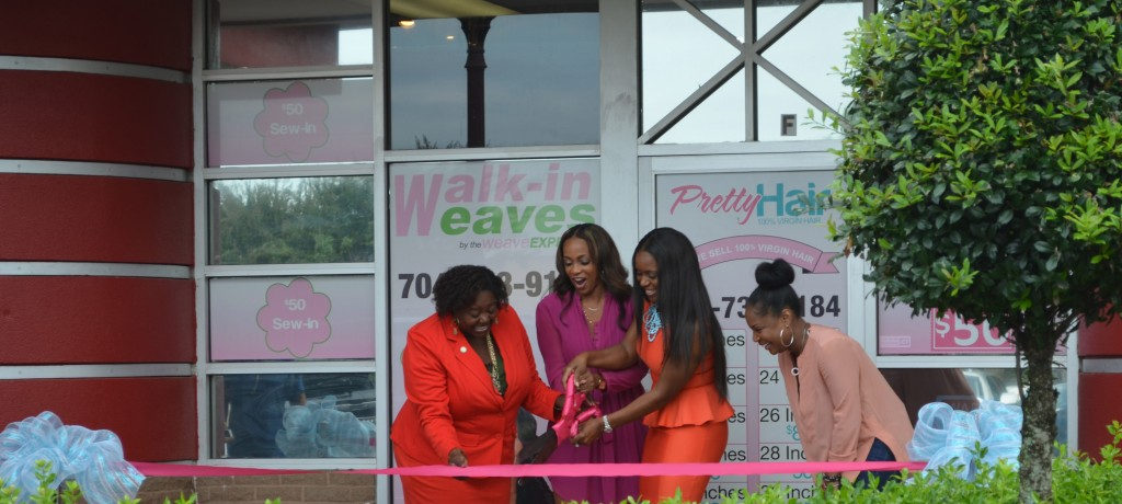 Maja Sly and LaWana Mayfield celebrating the opening of Walk-In Weaves